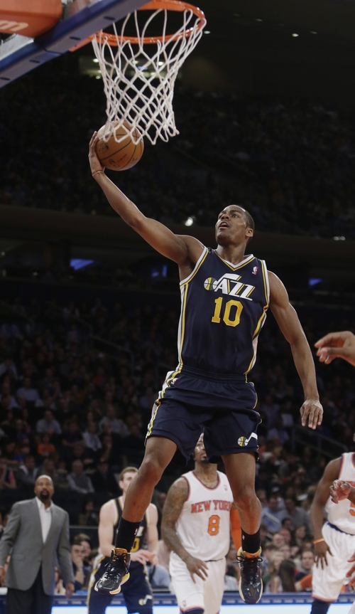 Utah Jazz's Alec Burks (10) drives past New York Knicks' J.R. Smith (8) during the first half of an NBA basketball game on Friday, March 7, 2014, in New York. (AP Photo/Frank Franklin II)