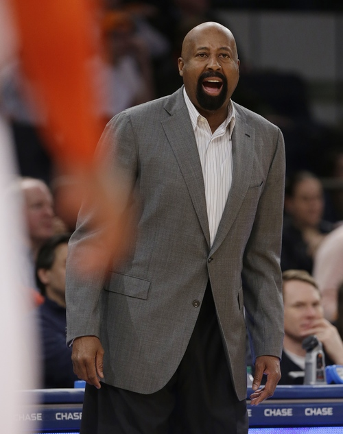 New York Knicks' Mike Woodson calls out to his team during the first half of an NBA basketball game against the Utah Jazz, Friday, March 7, 2014, in New York. (AP Photo/Frank Franklin II)