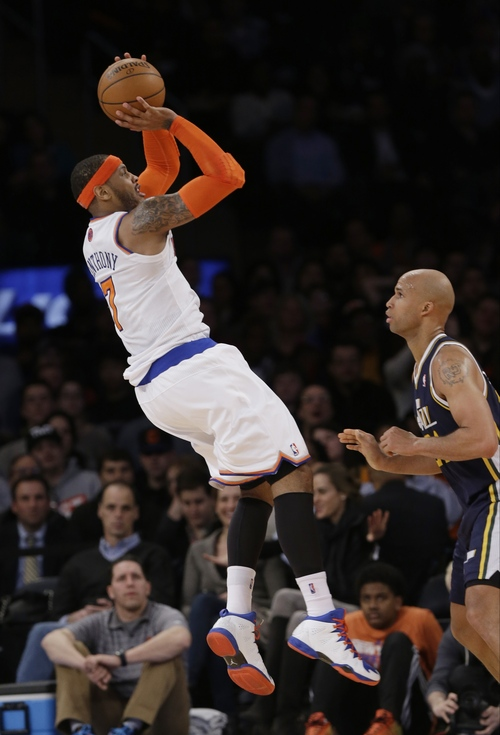 New York Knicks' Carmelo Anthony, left, shoots over Utah Jazz's Richard Jefferson during the first half of an NBA basketball game on Friday, March 7, 2014, in New York. (AP Photo/Frank Franklin II)