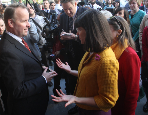 Rick Egan      Tribune file photo   Doug Peterson refuses to let Kate Kelly (right) into the standby line in the Tabernacle, as  Kelly and the group,  Ordain Women try to gain admittance to the Priesthood session of the 183rd Semi-annual General Conference, Saturday, October 5, 2013.