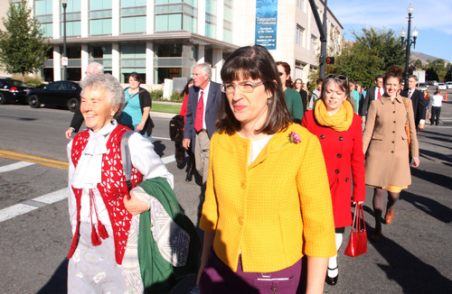 Rick Egan  |   Tribune file photo   Nadine Hansen (left) and Katie Kelly lead the group Ordain Women as they walk to LDS Conference Center to stand in the standby line to try to gain admittance to the Priesthood session of the 183rd Semi-annual General Conference, Saturday, October 5, 2013.