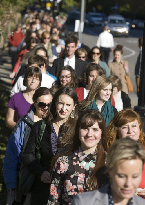 Rick Egan  |   Tribune file photo   Members of the group Ordain Women walk to LDS Conference Center to stand in the standby line to try to gain admittance to the Priesthood session of the 183rd Semi-annual General Conference, Saturday, October 5, 2013.