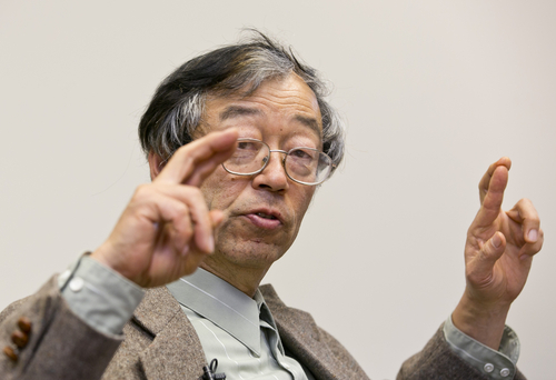 Dorian S. Nakamoto gestures during an interview with the Associated Press, Thursday, March 6, 2014 in Los Angeles. Nakamoto, the man that Newsweek claims is the founder of Bitcoin, denies he had anything to do with it and says he had never even heard of the digital currency until his son told him he had been contacted by a reporter three weeks ago. (AP Photo/Damian Dovarganes)