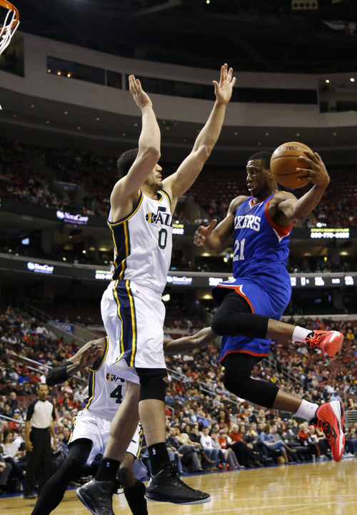 Philadelphia 76ers' Thaddeus Young (21) goes up to shoot against Utah Jazz's Enes Kanter (0) during the first half of an NBA basketball game on Saturday, March 8, 2014, in Philadelphia. (AP Photo/Matt Slocum)