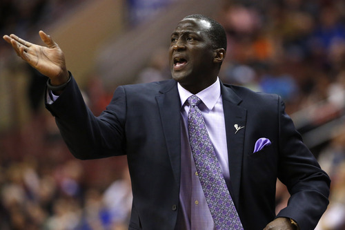 Utah Jazz head coach Tyrone Corbin yells to his team during the first half of an NBA basketball game against the Philadelphia 76ers, Saturday, March 8, 2014, in Philadelphia. (AP Photo/Matt Slocum)