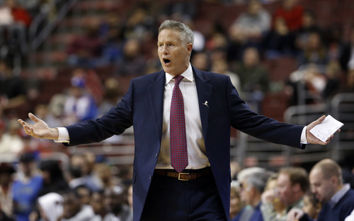 Philadelphia 76ers head coach Brett Brown reacts to a call during the first half of an NBA basketball game against the Utah Jazz, Saturday, March 8, 2014, in Philadelphia. (AP Photo/Matt Slocum)
