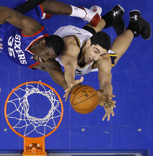 Philadelphia 76ers' Henry Sims, left, and Utah Jazz's Enes Kanter reach for a rebound during the second half of an NBA basketball game on Saturday, March 8, 2014, in Philadelphia. (AP Photo/Matt Slocum)