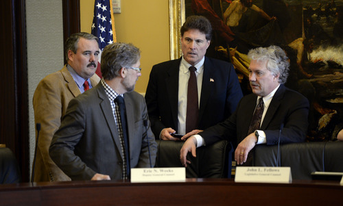 Francisco Kjolseth  |  The Salt Lake Tribune Members of the House Special Investigative Committee, including Rep. Lee Perry, R-Perry, deputy general counsel Eric Weeks, Rep. Jim Dunnigan, R-Taylorsville, and Legislative Counsel John Fellows, from left, get ready to close the meeting to discuss the report investigating former Attorney General John Swallow. The committee will go over the 200-plus-page report and meet again next week.