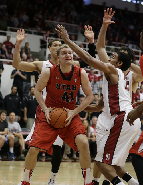 Utah forward Jeremy Olsen (41) tries to go to the basket between Stanford forwards Dwight Powell, left, and Josh Huestis, right, during the first half of their NCAA college basketball game Saturday, March 8, 2014, in Stanford, Calif. (AP Photo/Eric Risberg)