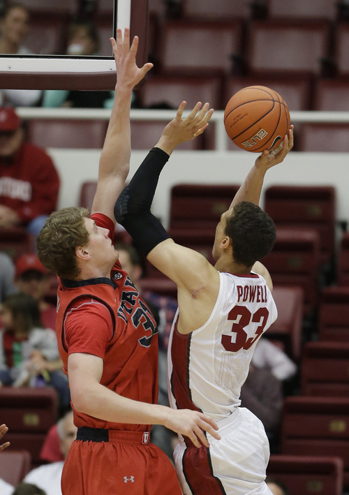Stanford forward Dwight Powell, right, goes to the basket against Utah center Dallin Bachynski, left, during the first half of an NCAA college basketball game Saturday, March 8, 2014, in Stanford, Calif. (AP Photo/Eric Risberg)
