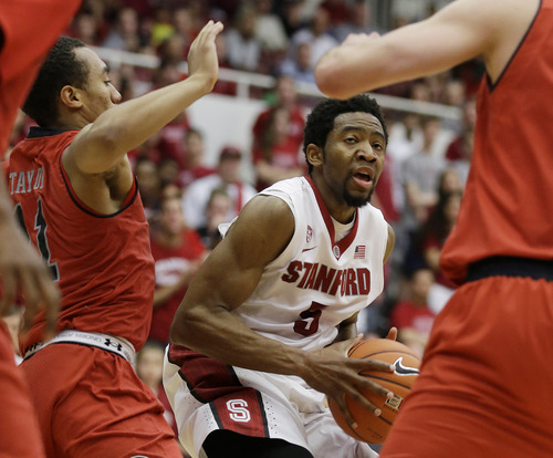 Stanford guard Chasson Randle, right, goes to the basket as Utah guard Brandon Taylor, left, defends during the second half of their NCAA college basketball game Saturday, March 8, 2014, in Stanford, Calif. Stanford won the game 61-60. (AP Photo/Eric Risberg)