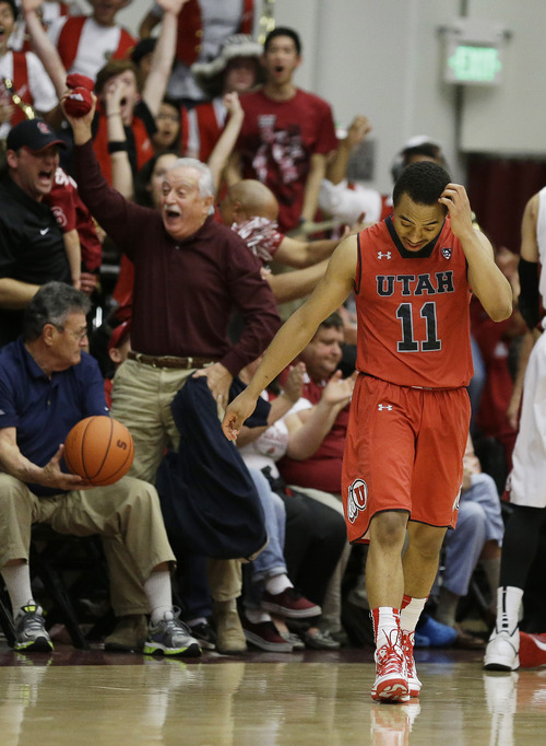 Utah guard Brandon Taylor reacts after being called for traveling in the final seconds of an NCAA college basketball game against Stanford Saturday, March 8, 2014, in Stanford, Calif. Stanford won the game 61-60. (AP Photo/Eric Risberg)