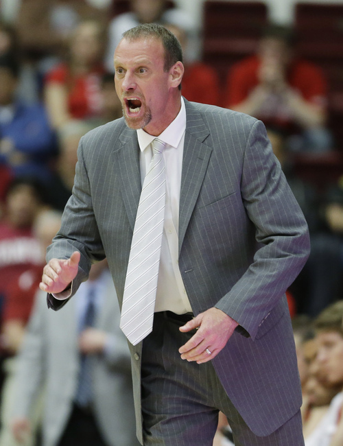 Utah head coach Larry Krystkowiak shouts from the bench during the second half of their NCAA college basketball game against Stanford Saturday, March 8, 2014, in Stanford, Calif. Stanford won the game 61-60. (AP Photo/Eric Risberg)