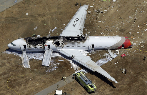 "FILE - In this July 6, 2013 aerial file photo, the wreckage of Asiana Flight 214 lies on the ground after it crashed at the San Francisco International Airport, in San Francisco. The Boeing 777 has one of the best safety records in aviation history. It first carried passengers in June 1995 and went 18 years without a fatal accident. That streak came to an end with the July 2013 Asiana crash. Three of the 307 people aboard that flight died. ""It's one of the most reliable airplanes ever built,"" said John Goglia, a former member of the U.S. National Transportation Safety Board. (AP Photo/Marcio Jose Sanchez, file)"