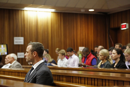 Oscar Pistorius, front left, listens to cross questioning in court during his trial at the high court in Pretoria, South Africa, Friday, March 7, 2014. Pistorius is charged with murder for the shooting death of his girlfriend,  Steenkamp, on Valentines Day in 2013. (AP Photo/Schalk van Zuydam, Pool)