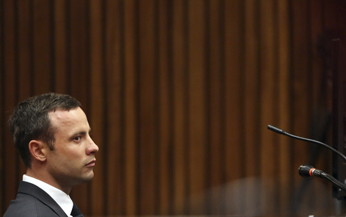 Oscar Pistorius listens to proceedings  in court during his trial at the high court in Pretoria, South Africa, Friday, March 7, 2014. Pistorius is charged with murder for the shooting death of his girlfriend,  Steenkamp, on Valentines Day in 2013. (AP Photo/Themba Hadebe, Pool)