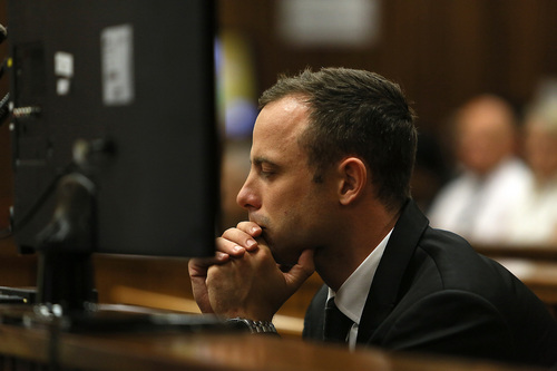 Oscar Pistorius in the dock on the third day of his trial at the high court in Pretoria, South Africa, Wednesday, March 5, 2014. Pistorius is charged with murder for the shooting death of his girlfriend, Reeva Steenkamp, on Valentines Day in 2013. (AP Photo/Alon Skuy, Pool)