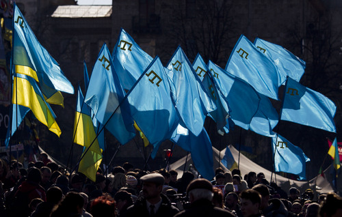 Demonstrators hold Ukrainian and Crimean Tatar flags during a protest in support of Crimean Tatars in Kiev's Independence Square, Ukraine, Saturday, March 8, 2014. As Crimea's parliament proceeds with plans for a referendum on the peninsula's future, the area's largest ethnic minority, the Tatars, feel increasingly threatened. (AP Photo/David Azia)