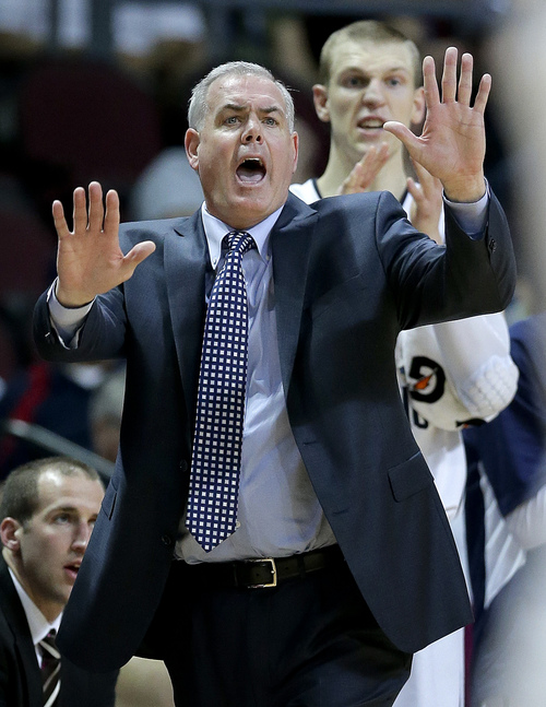 BYU coach Dave Rose motions to players in the second half of a quarterfinal West Coast Conference NCAA college basketball tournament game against Loyola Marymount, Saturday, March 8, 2014, in Las Vegas. (AP Photo/Julie Jacobson)