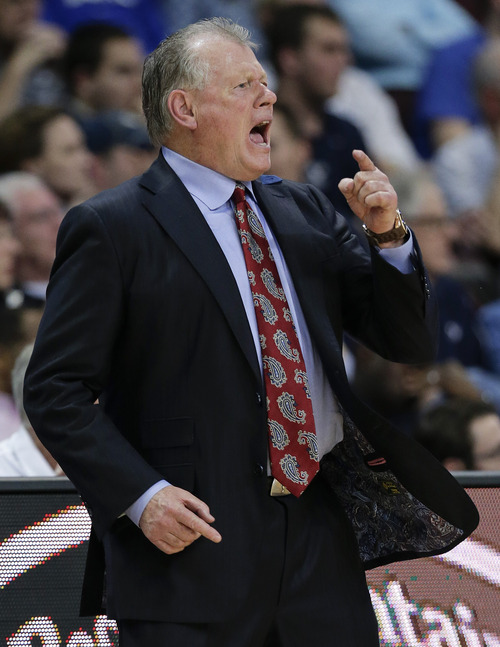 Loyola Marymount head coach Max Good shouts to a referee in the second half of a quarterfinal West Coast Conference NCAA college basketball tournament game against BYU, Saturday, March 8, 2014, in Las Vegas. (AP Photo/Julie Jacobson)