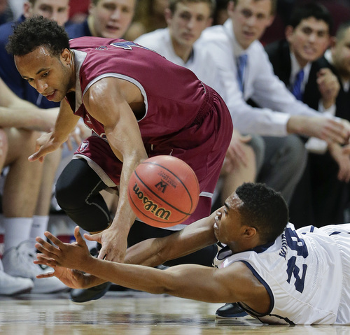 Loyola Marymount's Evan Payne, left, and BYU's Anson Winder scramble for a loose ball in the first half of a quarterfinal West Coast Conference NCAA college basketball tournament game on Saturday, March 8, 2014, in Las Vegas. (AP Photo/Julie Jacobson)