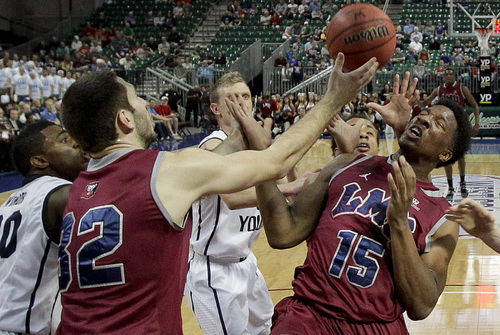 Loyola Marymount's Alex Osborne (15) and Gabe Levin (32) battle for a rebound against BYU in the first half of a quarterfinal West Coast Conference NCAA college basketball tournament game on Saturday, March 8, 2014, in Las Vegas. BYU won 85-74. (AP Photo/Julie Jacobson)