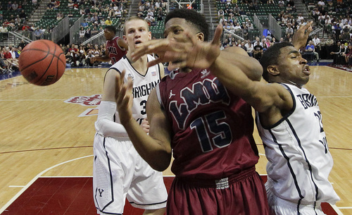 Loyola Marymount's Alex Osborne (15) battles for a rebound against BYU's Anson Winder in the first half of a quarterfinal West Coast Conference NCAA college basketball tournament game on Saturday, March 8, 2014, in Las Vegas. BYU won 85-74. (AP Photo/Julie Jacobson)