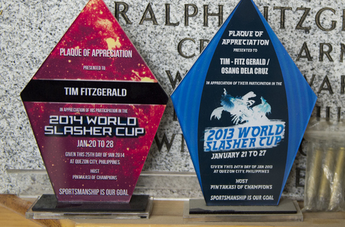 Keith Johnson | The Salt Lake Tribune  Plaques of appreciation from Tim Fitzgerald attending the 20013 and 2014 World Slasher Cup in the Philippines, sit on a shelf at his home in Bluffdale, Utah, March 3, 2014. Fitzgerald is an advocate to legalize cock fighting in Utah.