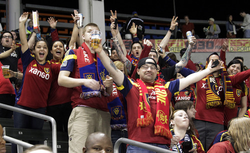Real Salt Lake fans cheer before their game against the Los Angeles Galaxy in an MLS soccer game in Carson, Calif., Saturday, March 8, 2014.  Real Salt Lake won, 1-0. (AP Photo/Reed Saxon)