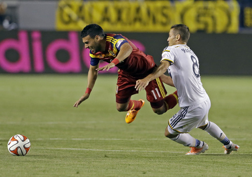 Real Salt Lake midfielder Javier Morales (11) and Los Angeles Galaxy midfielder Marcelo Sarvas (8) tangle in the first half of an MLS soccer game in Carson, Calif., Saturday, March 8, 2014.  Real Salt Lake won, 1-0. (AP Photo/Reed Saxon)