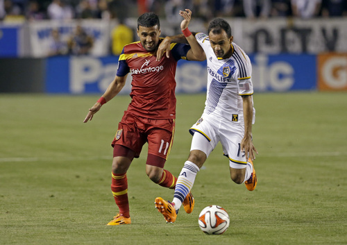 Real Salt Lake midfielder Javier Morales (11) and Los Angeles Galaxy midfielder Juinho tangle in the first half of an MLS soccer game in Carson, Calif., Saturday, March 8, 2014.  (AP Photo/Reed Saxon)