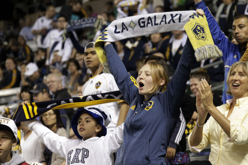 Los Angeles Galaxy fans cheer before a game against Real Salt Lake in an MLS soccer game in Carson, Calif., Saturday, March 8, 2014.  (AP Photo/Reed Saxon)