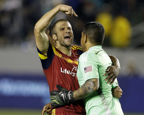 Real Salt Lake defender Chris Wingert, left, embraces goalkeeper Nick Rimando after their defeat of the Los Angeles Galaxy in the second half of an MLS soccer game in Carson, Calif., Saturday, March 8, 2014.  Real Salt Lake won, 1-0. (AP Photo/Reed Saxon)
