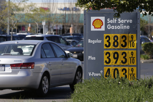 In this photo taken Friday March 7, 2014,  gas prices are displayed at a Shell station in Sacramento, Calif.  Starting 2015 California motorists will be hit in the pocketbook by the state's greenhouse gas reduction law AB32.  Signed into law by Gov. Arnold Schwarzenegger in 2006, AB32 will force fuel distributors into the same cap-and-trade marketplace as utilities and major manufacturers.  The oil industry says it will lead to price increase of at least 12 cents a gallon immediately, while state regulators say any price spikes could vary widely, from barely noticeable to double-digits.(AP Photo/Rich Pedroncelli)