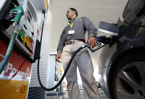 In this photo taken Friday March 7, 2014, Eric Henry gases up his car in Sacramento, Calif.  Starting 2015 California motorists will be hit in the pocketbook by the state's greenhouse gas reduction law AB32.  Signed into law by Gov. Arnold Schwarzenegger in 2006, AB32 will force fuel distributors into the same cap-and-trade marketplace as utilities and major manufacturers.  The oil industry says it will lead to price increase of at least 12 cents a gallon immediately, while state regulators say any price spikes could vary widely, from barely noticeable to double-digits.  Henry said he isn't in favor of a big spike in gas prices but agreed that higher prices are probably needed to force people to make changes in their consumption.(AP Photo/Rich Pedroncelli)