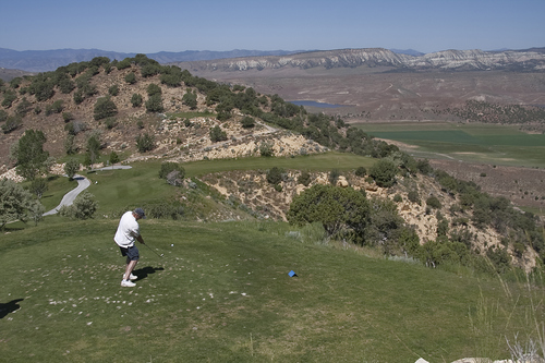 Margaret Distler  |  The Salt Lake Tribune  The Salt Lake Tribune sports writer Gordon Monson tees off on hole 4 at Palisade State Park golf course in Sterling, Utah on Monday, June 27, 2011. The hole overlooks the Palisade Reservoir and the surrounding Sanpete County.
