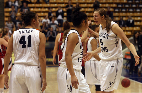 Kim Raff  |  The Salt Lake Tribune BYU player (left) Morgan Bailey, Keilani Unga and Jennifer Hamson celebrate after defeating St. Mary's 66-58 at the Marriott Center in Provo on January 31, 2013.