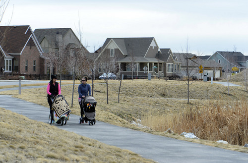 Rick Egan  | The Salt Lake Tribune   Katrina Kirk and Kara Larson take a walk in  their Daybreak neighborhood, Friday, February 28, 2014.