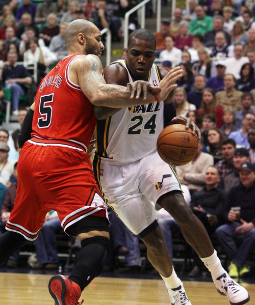 Kim Raff  |  The Salt Lake Tribune (right) Utah Jazz power forward Paul Millsap (24) drives the basket past Chicago Bulls power forward Carlos Boozer (5) during the first half at EnergySolutions Arena in Salt Lake City on February 8, 2013.