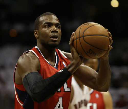 Atlanta Hawks power forward Paul Millsap (4) shots a free throw against the Toronto Raptors in the first half of an NBA basketball game Friday, Nov. 1, 2013, in Atlanta. (AP Photo/John Bazemore)