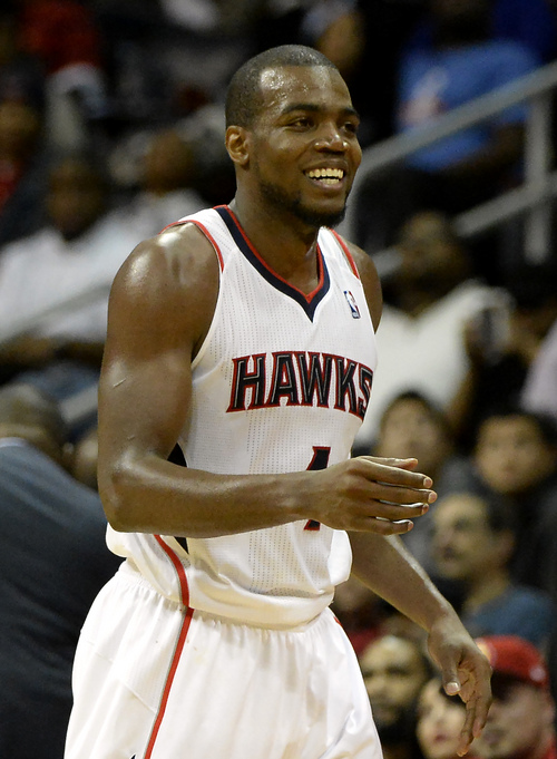 Atlanta Hawks forward Paul Millsap (4), who scored 20 points in the 83-80 win over the Houston Rockets, smiles as he walks from the court in the second half of an NBA basketball game on Friday, Jan. 10, 2014, in Atlanta. (AP Photo/David Tulis)