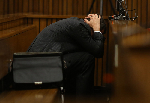 Oscar Pistorius buries his head in his hands covers his head as he listens   to cross questioning about the events surrounding the shooting death of his girlfriend Reeva Steenkamp, in his second week in court during his trial in Pretoria, South Africa, Monday, March 10, 2014. Pistorius is charged with the shooting death of his girlfriend  Steenkamp, on Valentines Day in 2013. (AP Photo/Siphiwe Sibeko, Pool)