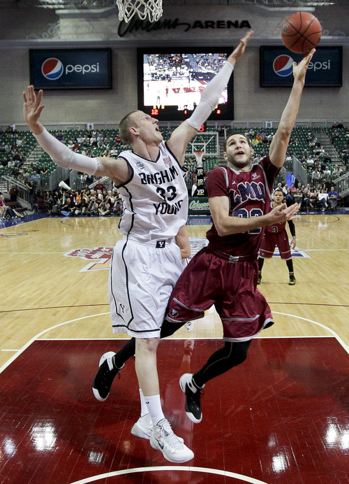 Loyola Marymount's Gabe Levin, right, shoots against BYU's Nate Austin in the first half of a quarterfinal West Coast Conference NCAA college basketball tournament game on Saturday, March 8, 2014, in Las Vegas. BYU won 85-74. (AP Photo/Julie Jacobson)
