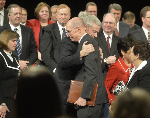 Keith Johnson | The Salt Lake Tribune  Henry Eyring, right, first counselor in the presidency of The Church of Jesus Christ of Latter-day Saints, hugs Kevin J. Worthen J.D., former dean of the J. Reuben Clark Law School and current advancement vice president of Brigham Young University, after a devotional where it was announced that Worthen will be the 13th president of BYU beginning on May 1, 2014.