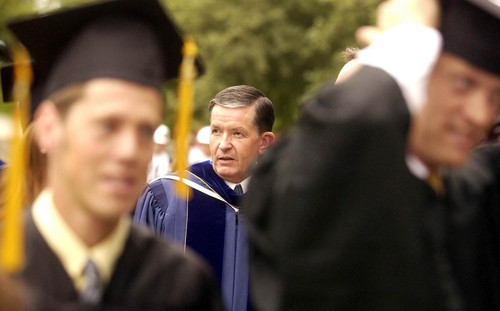 File photo  |  The Salt Lake Tribune  New BYU President Cecil O. Samuelson walks with students during his first commencement as BYU president in August 2003.
