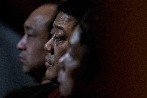 Relatives of Chinese passengers aboard missing Malaysia Airlines Flight MH370 watch a TV news program about the missing flight as they wait for official updates from Malaysia Airlines at a hotel ballroom in Beijing, China, Tuesday, March 11, 2014. Nearly three days after the Boeing 777 with 239 people on board disappeared en route from Kuala Lumpur to Beijing, no debris has been seen in Southeast Asian waters. (AP Photo/Alexander F. Yuan)