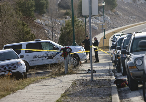 Kim Raff | The Salt Lake Tribune  Police investigate the area where Anne Kasprzak's body was found on March 11, 2012, in the Jordan River at 12300 south in Draper. A year later, no one has been charged with her murder.