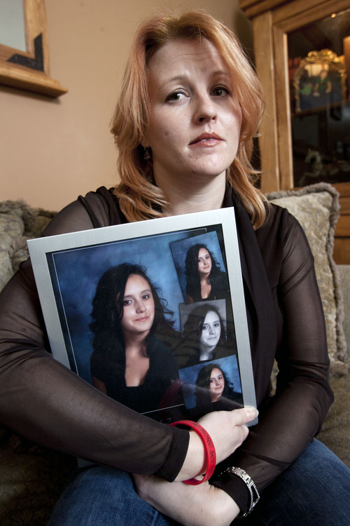 Steve Griffin | The Salt Lake Tribune  Veronica Kasprzak holds a photograph of her daughter, Anne Kasprzak, in the living room of her South Jordan, Utah home Wednesday March 6, 2013. Draper police announced that a man they arrested a year ago, for the murder Anne Kasprzak, is no longer a suspect.