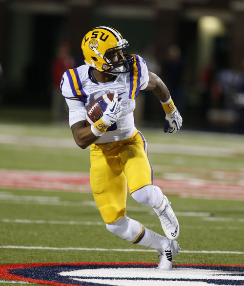 LSU wide receiver Odell Beckham Jr. (3) makes a first half reception against Mississippi in their NCAA college football game at Vaught-Hemingway Stadium in Oxford, Miss., Saturday, Oct. 19, 2013. Mississippi won 27-24. (AP Photo/Rogelio V. Solis)