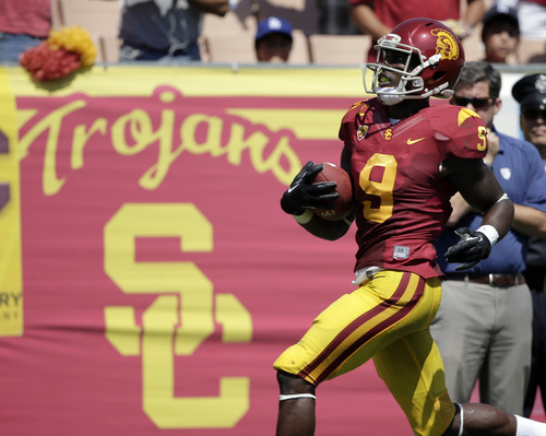 Southern California wide receiver Marqise Lee scores on a 80-yard pass play against Boston College during the first half of an NCAA college football game in Los Angeles, Saturday, Sept. 14, 2013. (AP Photo/Chris Carlson)